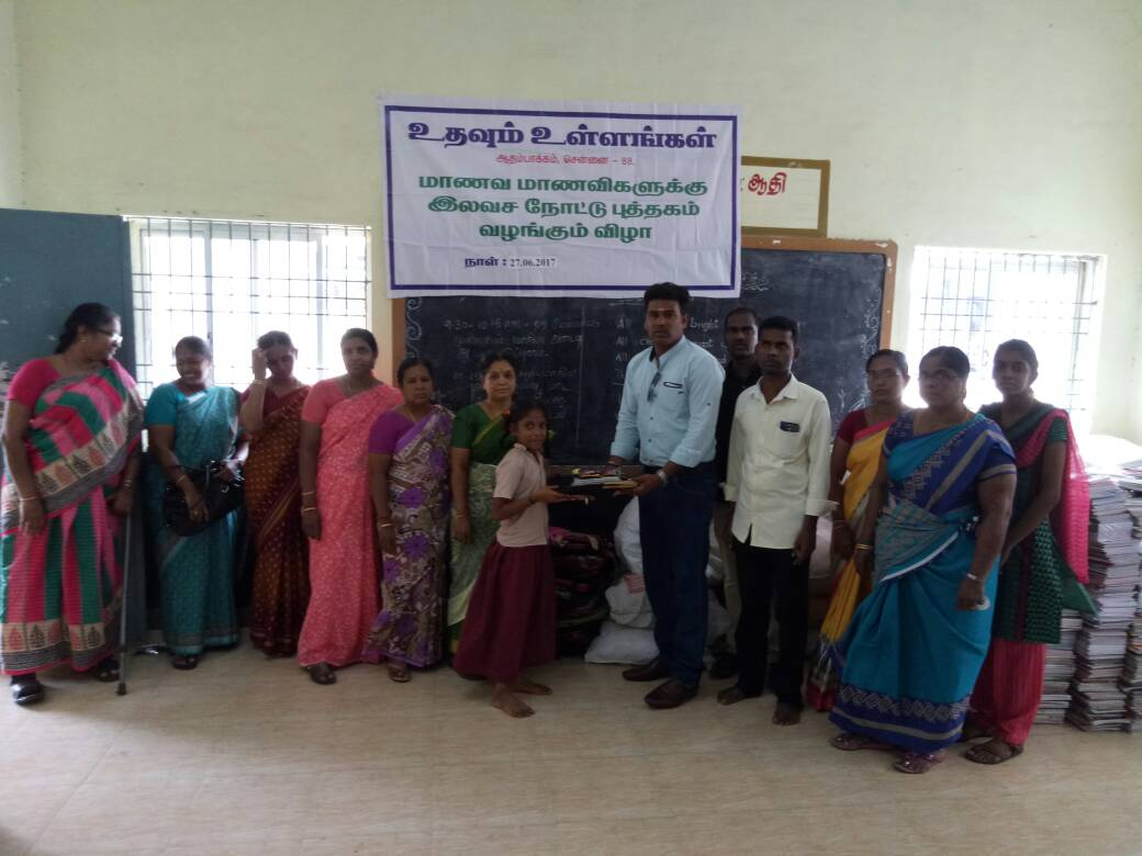 Poor school students at Adambakkam are donated with school aids